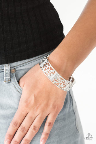 Filled with vine-like filigree, shimmery silver frames are threaded along stretchy bands around the wrist for a whimsical look. Dainty white rhinestones are sprinkled along the ornate frames for a sparkling finish.  Sold as one individual bracelet.  Always nickel and lead free.