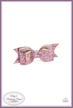 Load image into Gallery viewer, A classic white leather bow is dusted in blinding multicolored sparkles for the ultimate girly girl glamour.