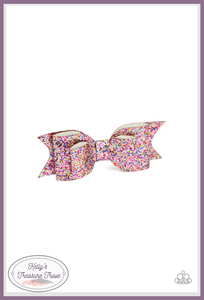 A classic white leather bow is dusted in blinding multicolored sparkles for the ultimate girly girl glamour.