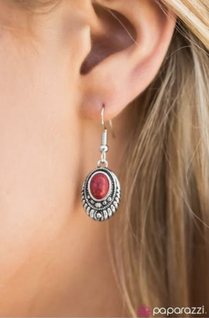 A robust red bead is pressed into the center of an ornate silver frame. Glittery hematite rhinestones are sprinkled along the textured frame, adding a refined shimmer to the seasonal palette. Earring attaches to a standard fishhook fitting.  Sold as one pair of earrings.  Always nickel and lead free.