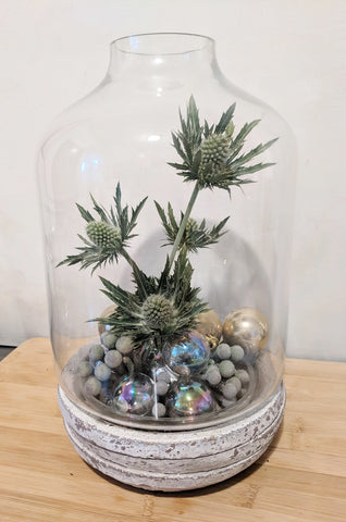 Terrarium with thistle and iridescent balls