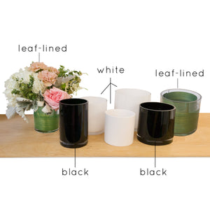 An assortment of white, black and leaf-lined vases from Hedonia Flowers.