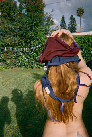 A woman from the back with panties on her head.