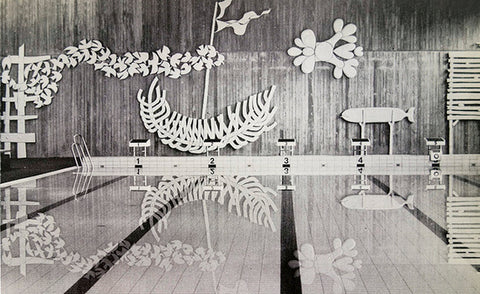 Black and white photo of a pool with white decor on the walls.