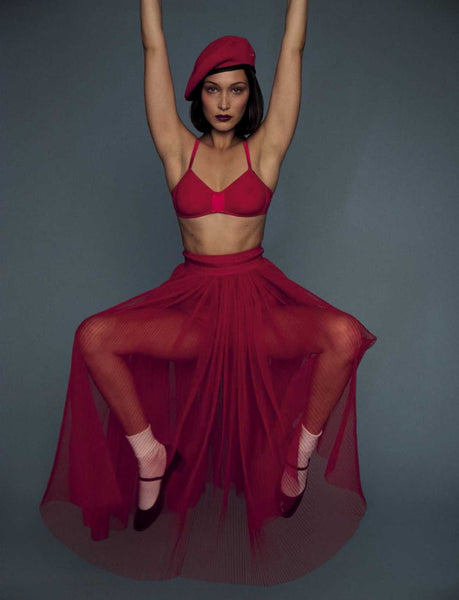 Woman in red bralette, red skirt and red leggings