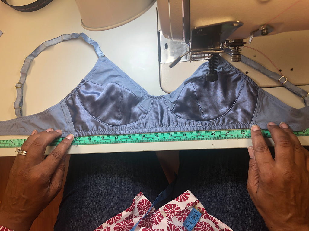 Bra on table with ruler