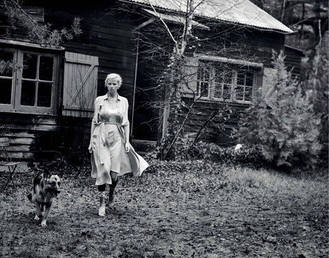 woman walking in white dress with dog