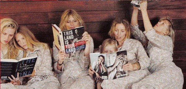 5 women, 1 child laying down with magazines