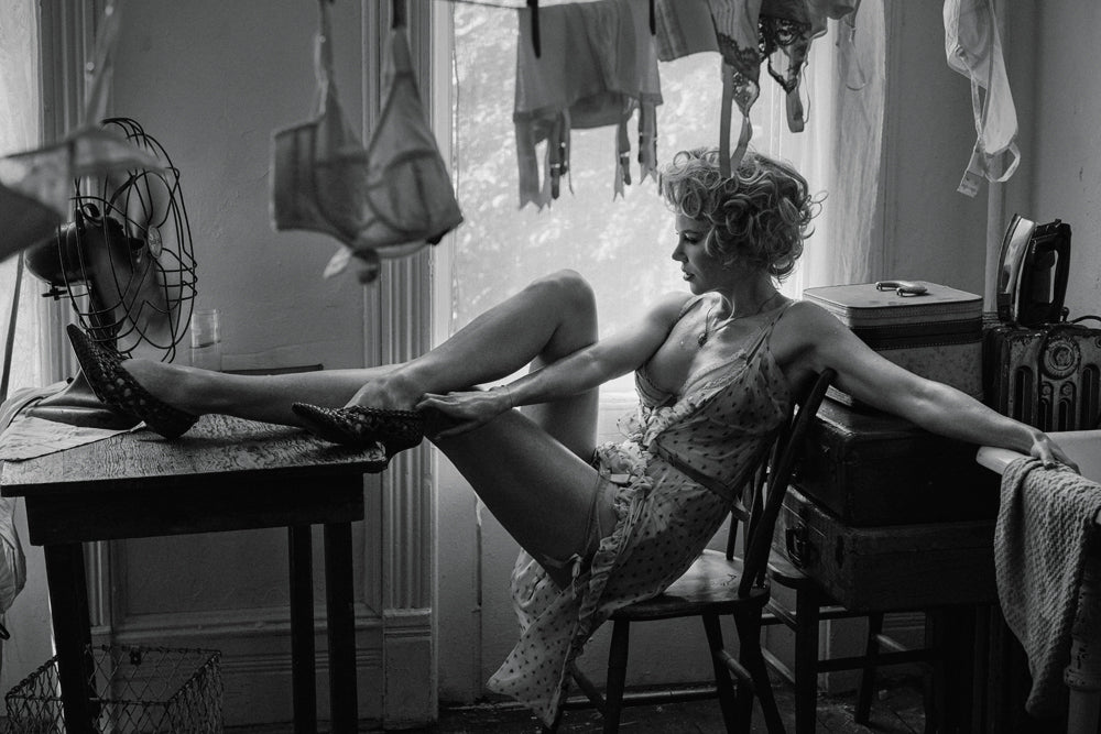 woman sitting on chair with feet on table wearing a dress