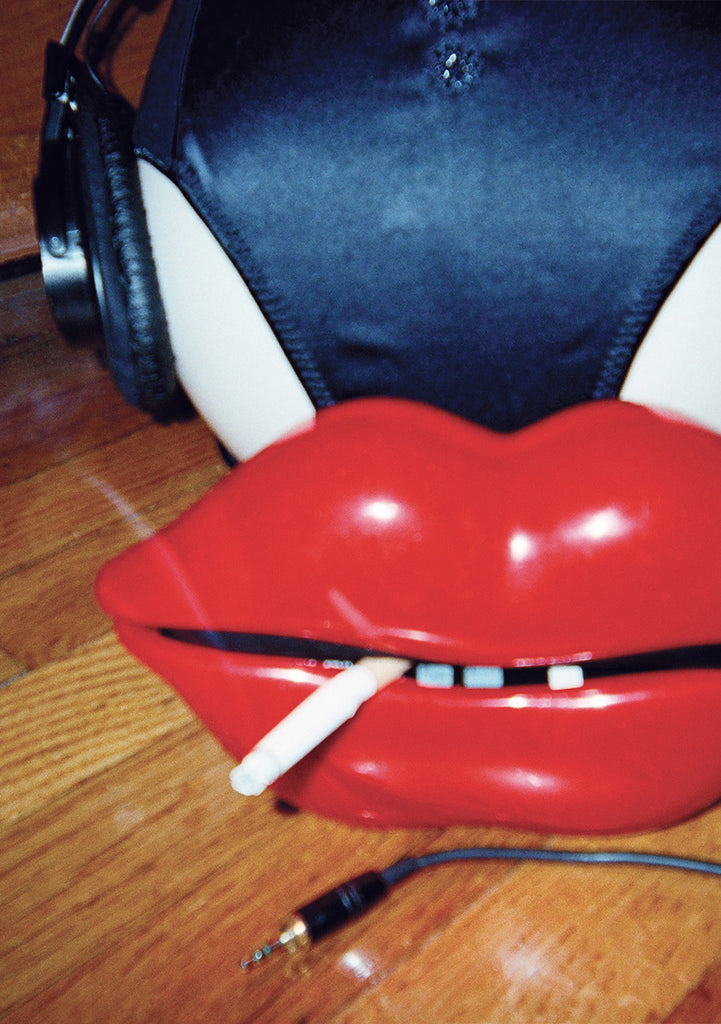 Headphones, navy panty, red lips, and cigarette
