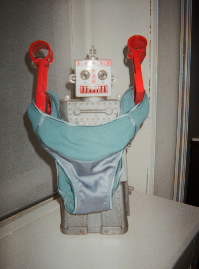 Toy robot displays turquoise panty with light blue silk front panel.