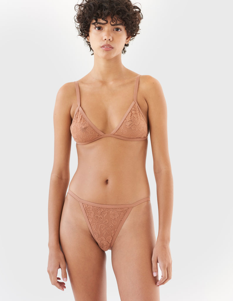 woman wearing brown string lace panty and matching triangle bra