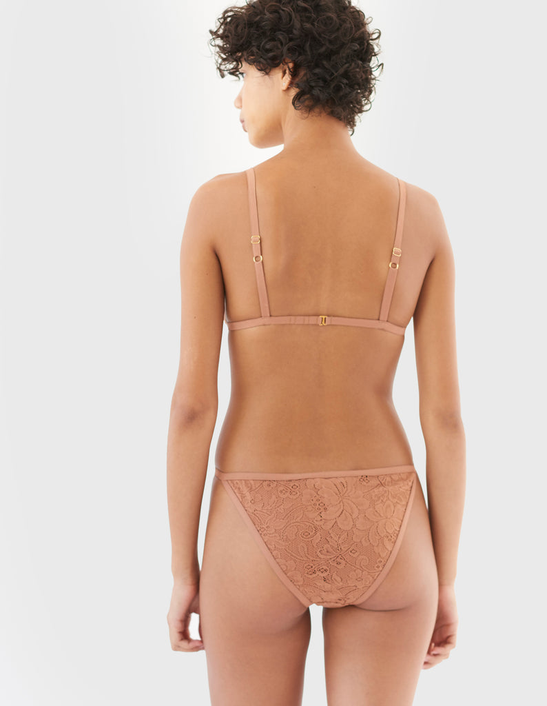 back of woman wearing brown string lace panty and matching triangle bra