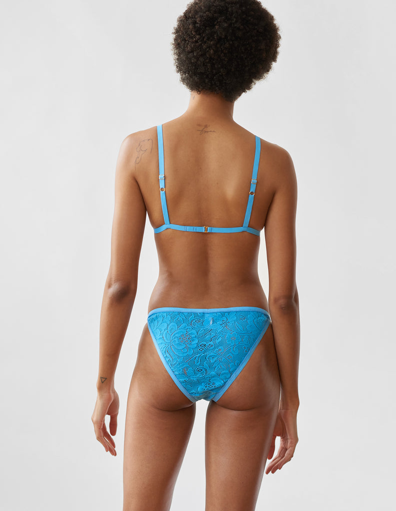 Woman wearing the Lace Bryce Bralette and Basja Panty in Blue.