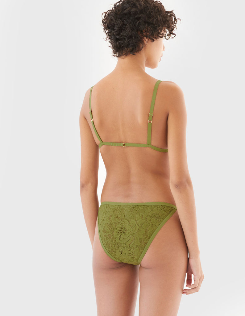 back of woman wearing green lace triangle bra and matching string panty
