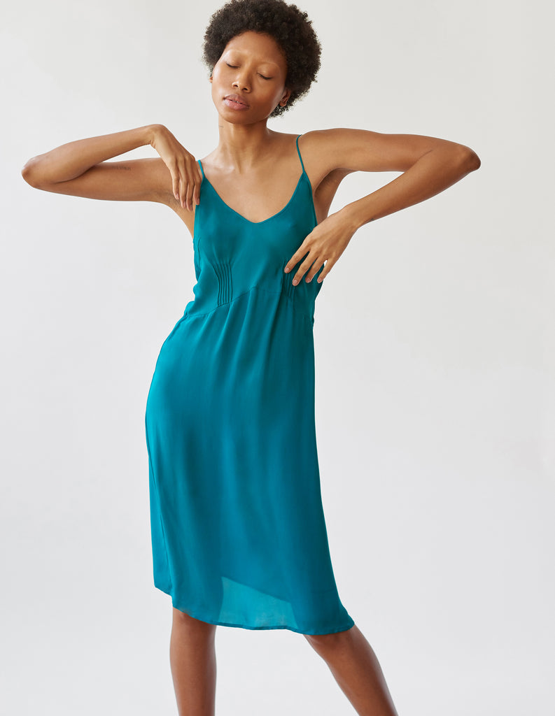 woman wearing green knee length slip