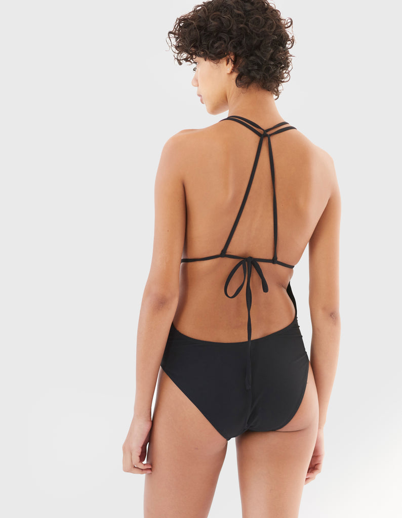 woman in black one piece swimsuit with string back by Araks