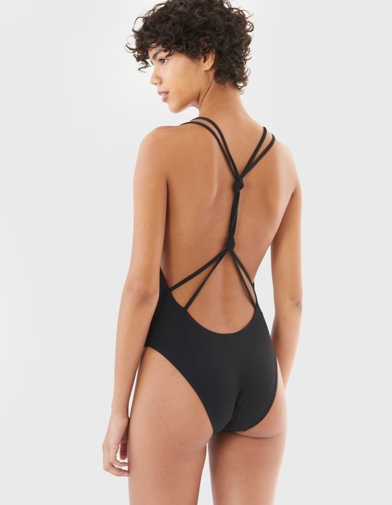 woman in black one piece with knotted back by Araks