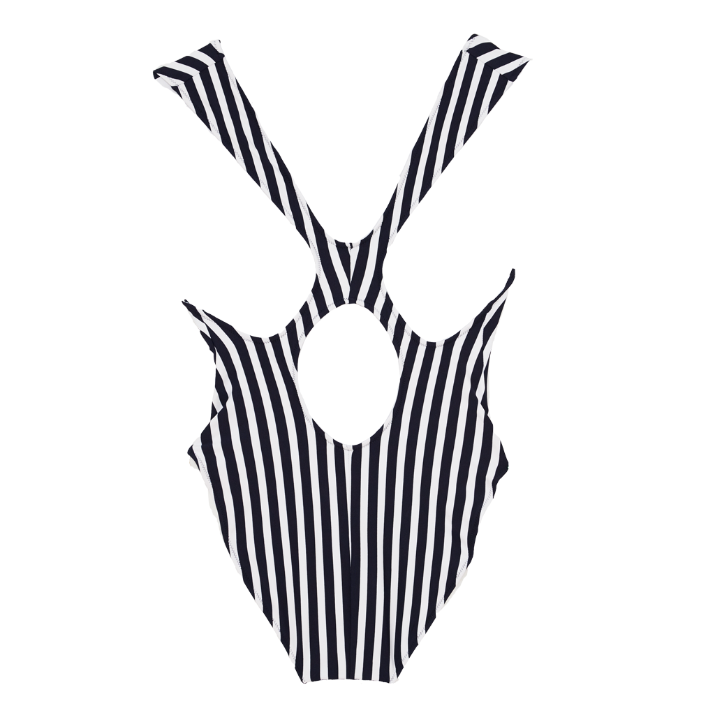 Back of black and white vertical stripe one piece swimsuit with wide shoulder straps that intersect at back.