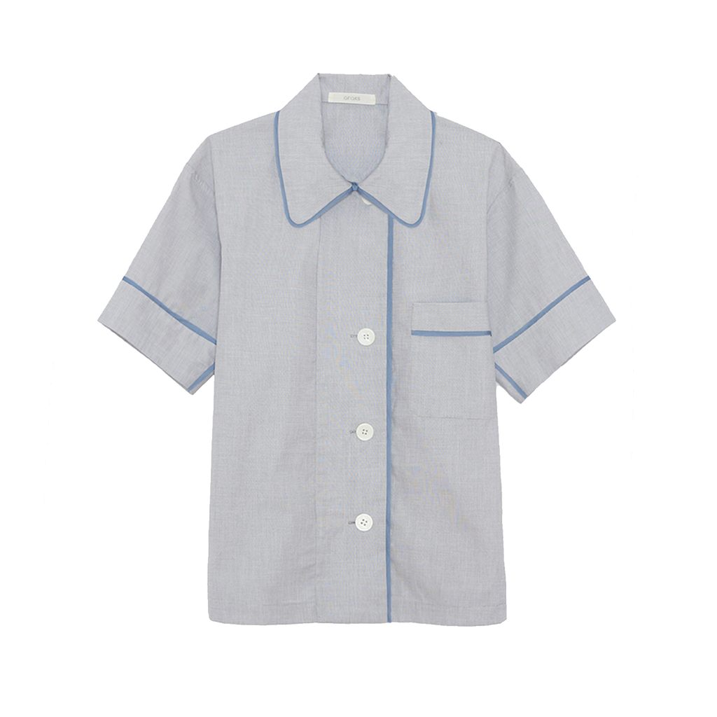Light blue cotton collared short-sleeved sleep shirt with left breast pocket and contrast piping