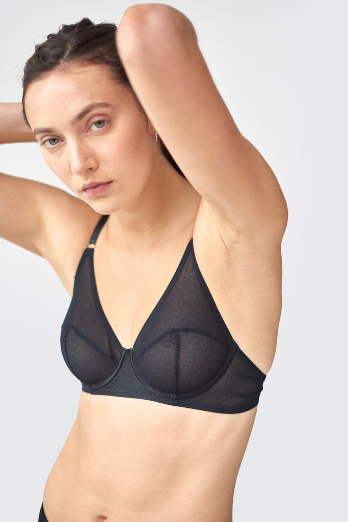 Front view of woman wears black mesh underwire bra