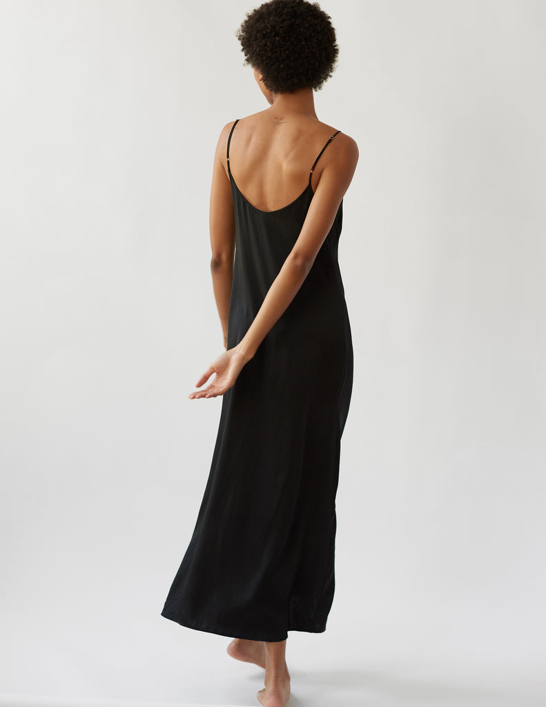 Woman in black silk slip