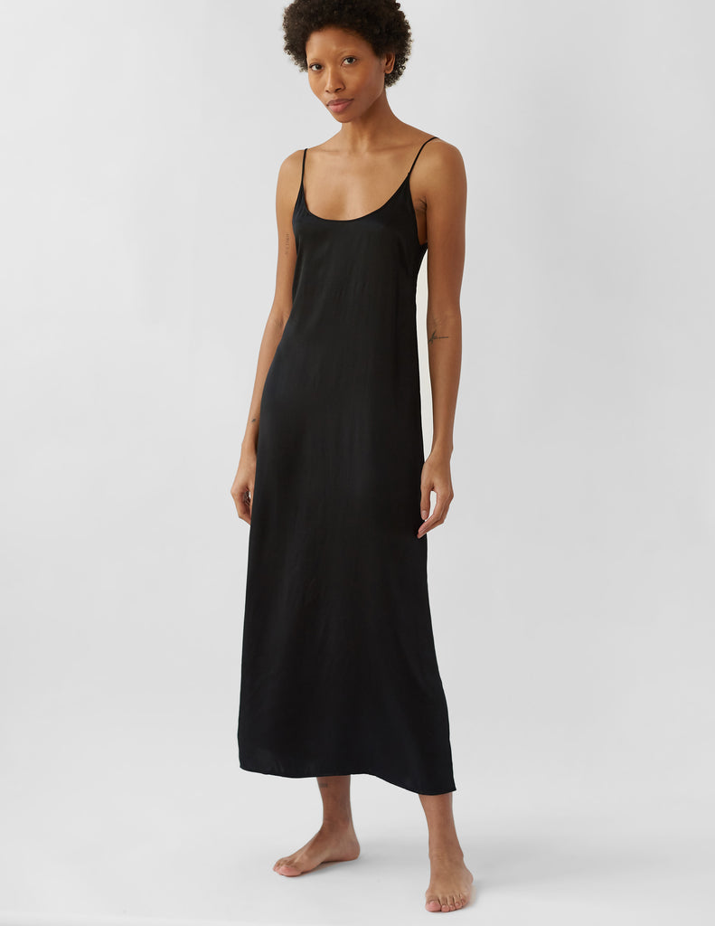 Woman in long black slip dress