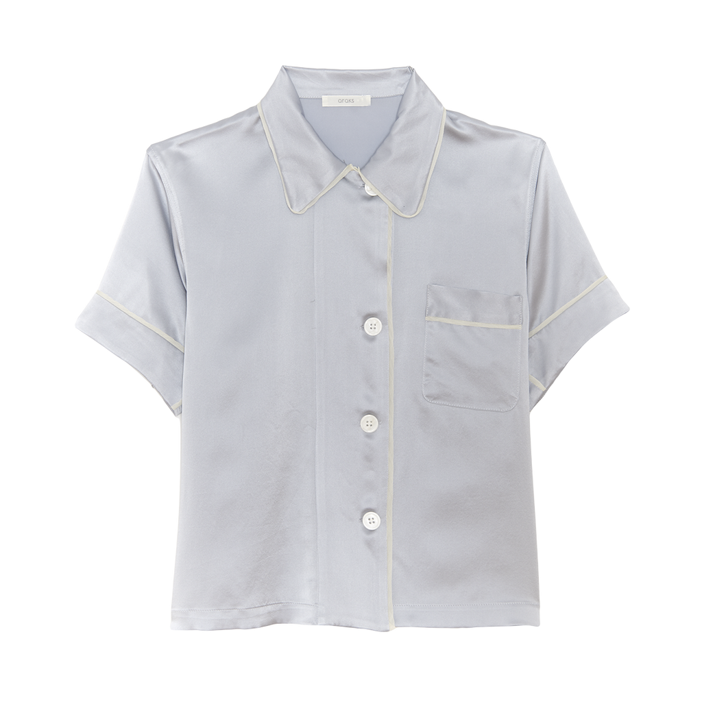 Light grey silk collared short-sleeved sleep shirt with left breast pocket and contrast piping