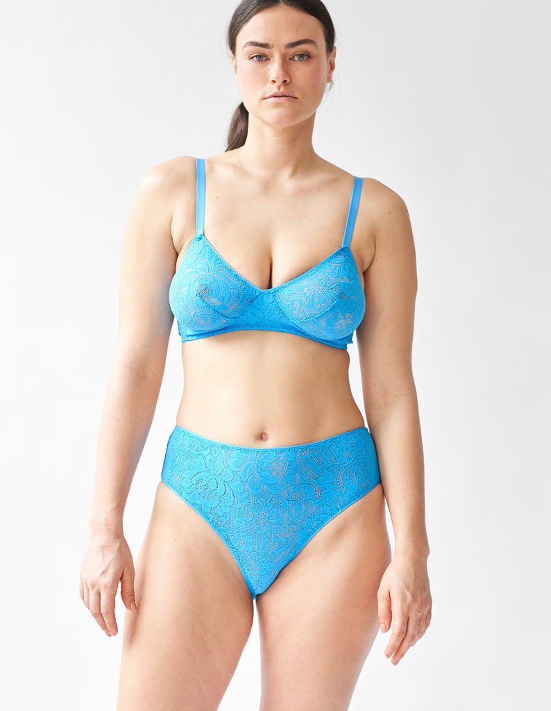 Woman wearing the blue lace Tamara Bralette and Tali lace panty.