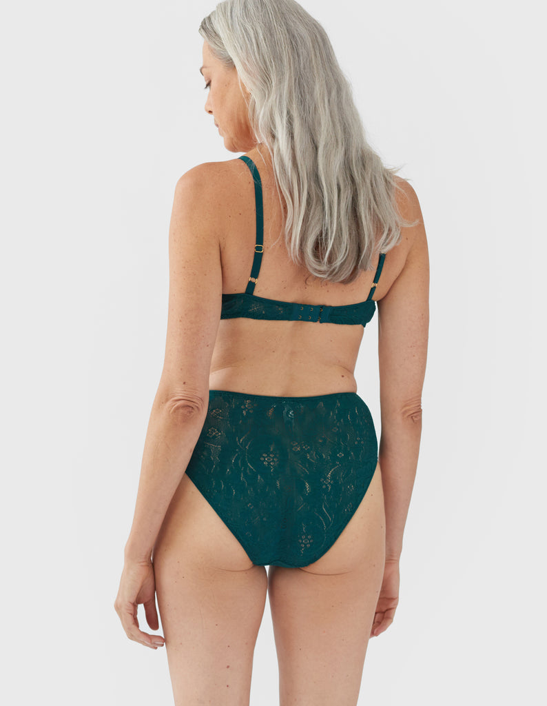 back shot of woman wearing green lace bra and high waist panty
