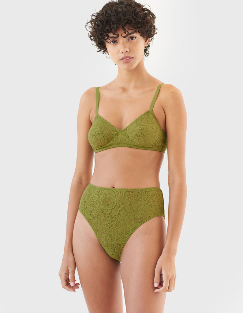 woman wearing green lace wireless bra and matching high waist panty