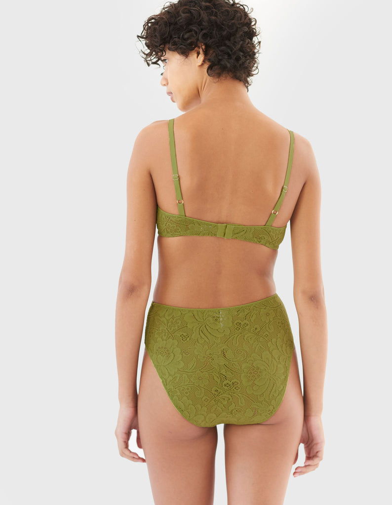 back of woman wearing green lace wireless bra and matching high waist panty