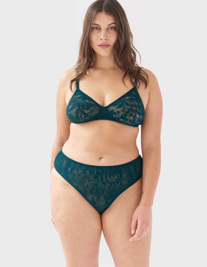 Front view of woman wearing green lace panty with matching bralette
