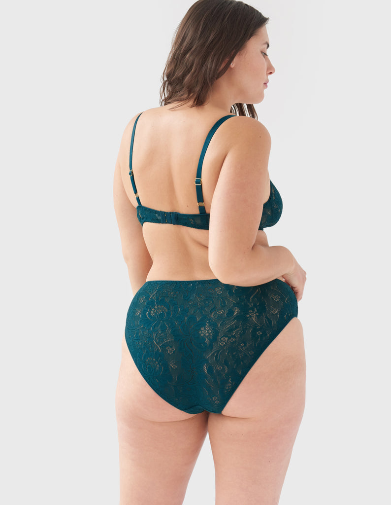 Back view of woman wearing green lace panty with matching bralette