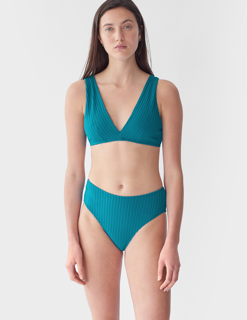 Model wearing, Turquoise rib bikini top and matching panty