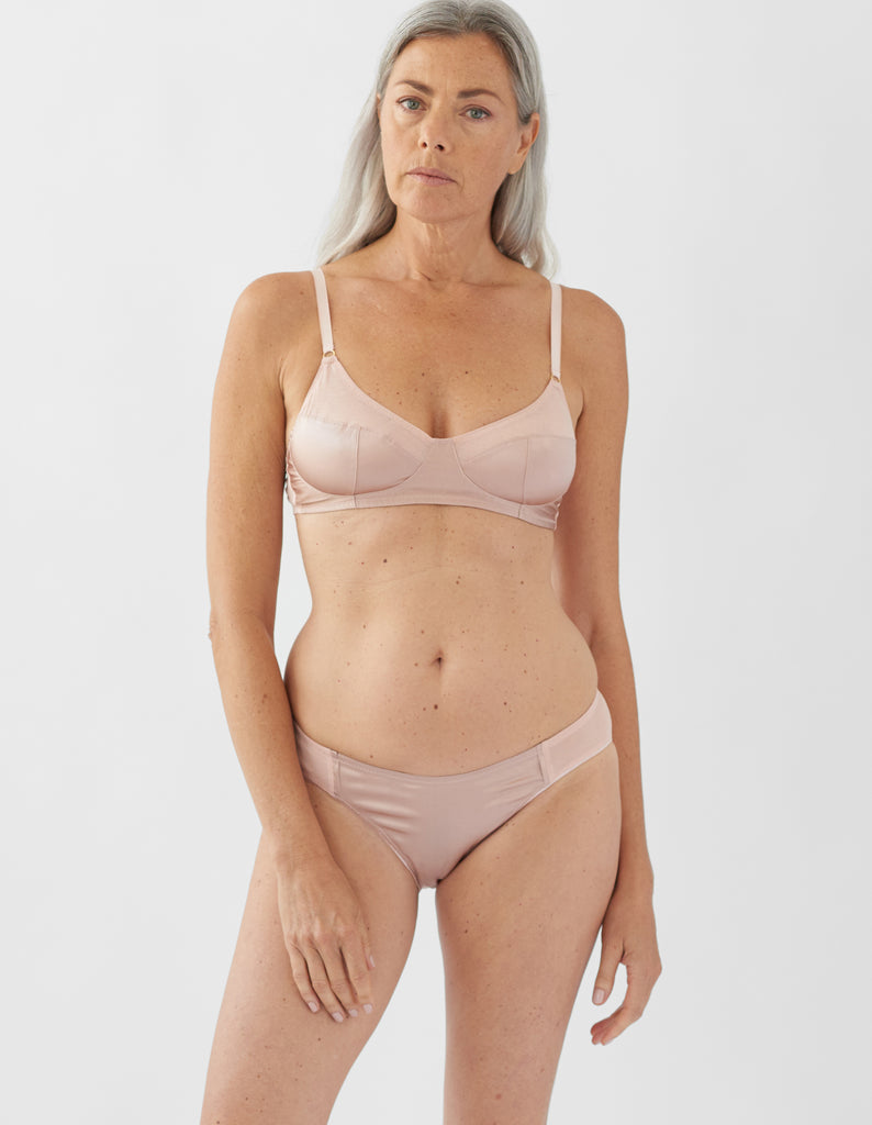 woman wearing beige  bra and matching panty