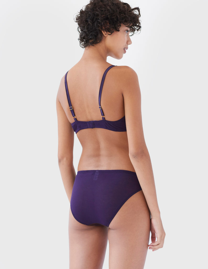 back of woman wearing two toned purple cotton and silk wireless bra and matching panty