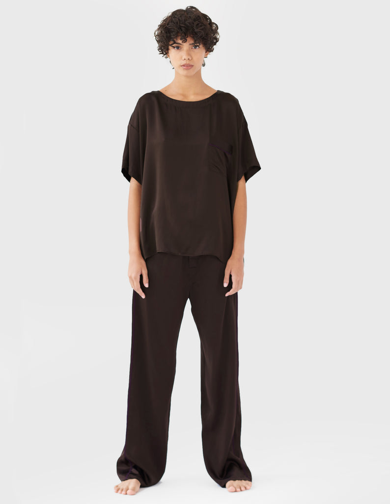 woman wearing brown silk t-shirt and matching pants