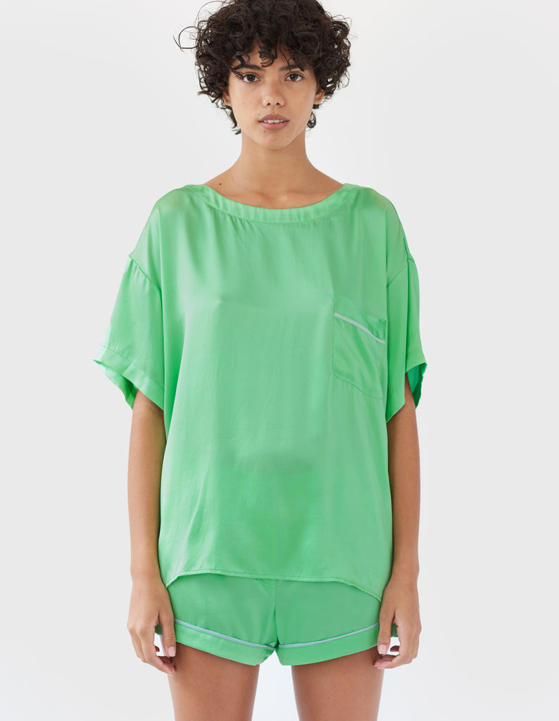 woman wearing green silk t-shirt and matching shorts