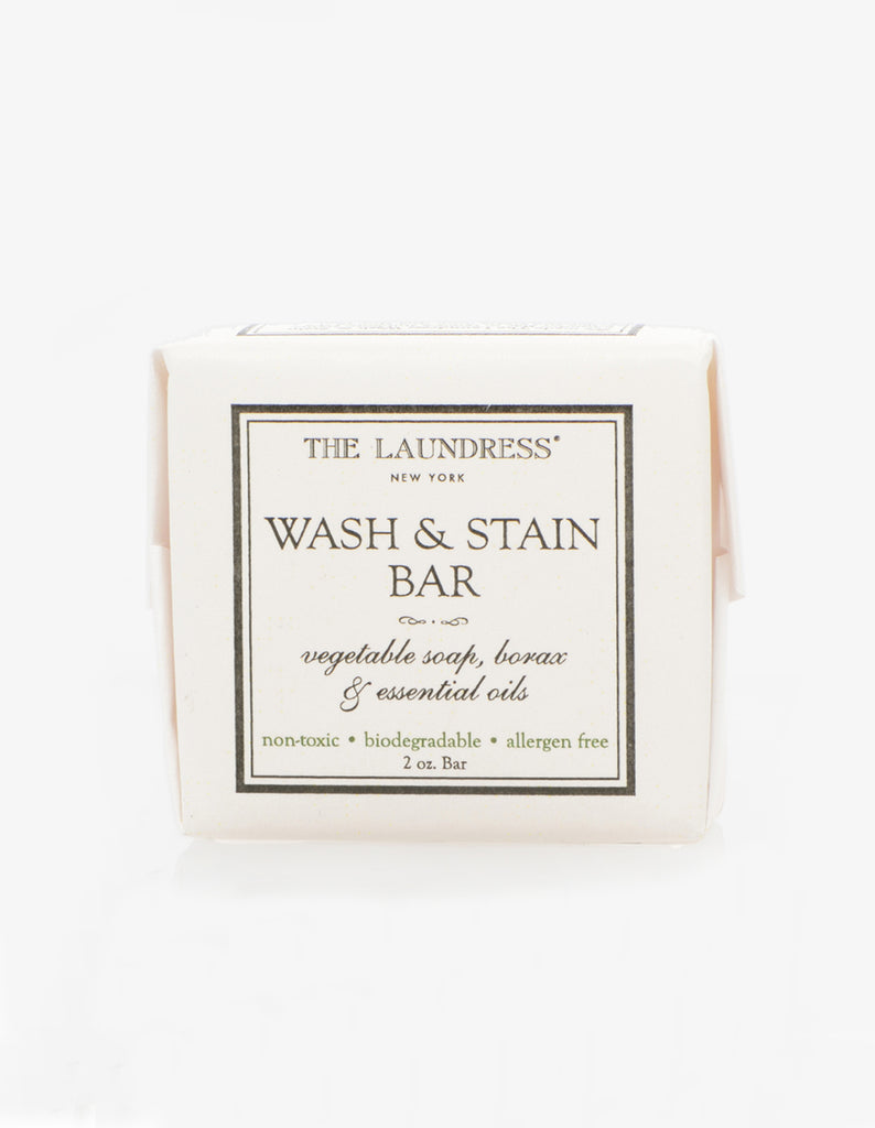 "White square packaged soap featuring the text ""The Laundress New York Wash & Stain Bar, vegetable soap. Borax & essential oils. Non-toxic, biodegradable, allergen-free"" on front."