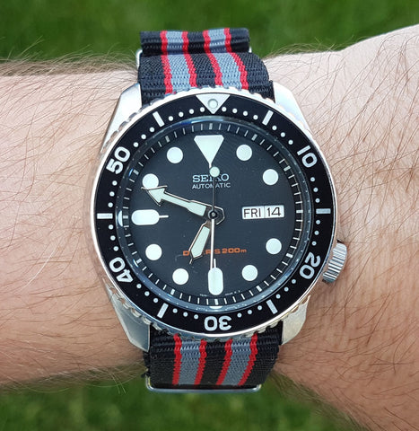 Seiko SKX007 on a 22mm Black and Grey with Red Nato from Watch Off The Cuff