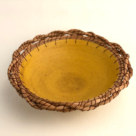 Ochre plate with twisted edge