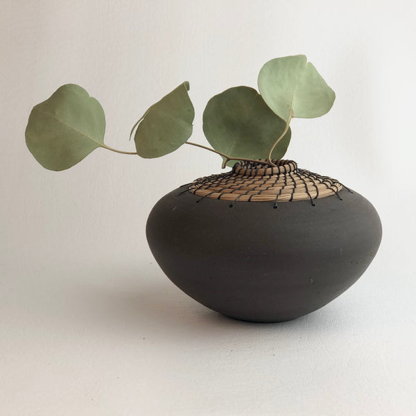 Black short flat bud vase