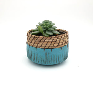 Turquoise pot holder with stripes