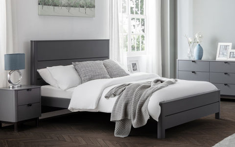 small single pocket spring and memory foam mattress with a bed frame