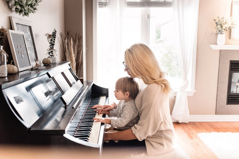 Female And Child Learning Playing Learning The Piano