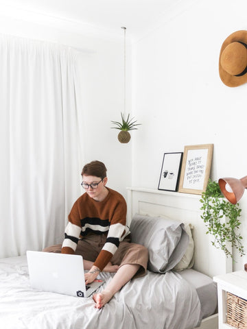 Female On A Laptop Resting On A Small Single Bed-Better Bed Company