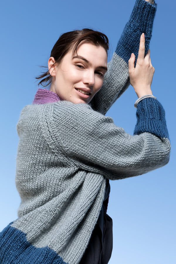 side view of silver  purple and blue pure wool cardigan