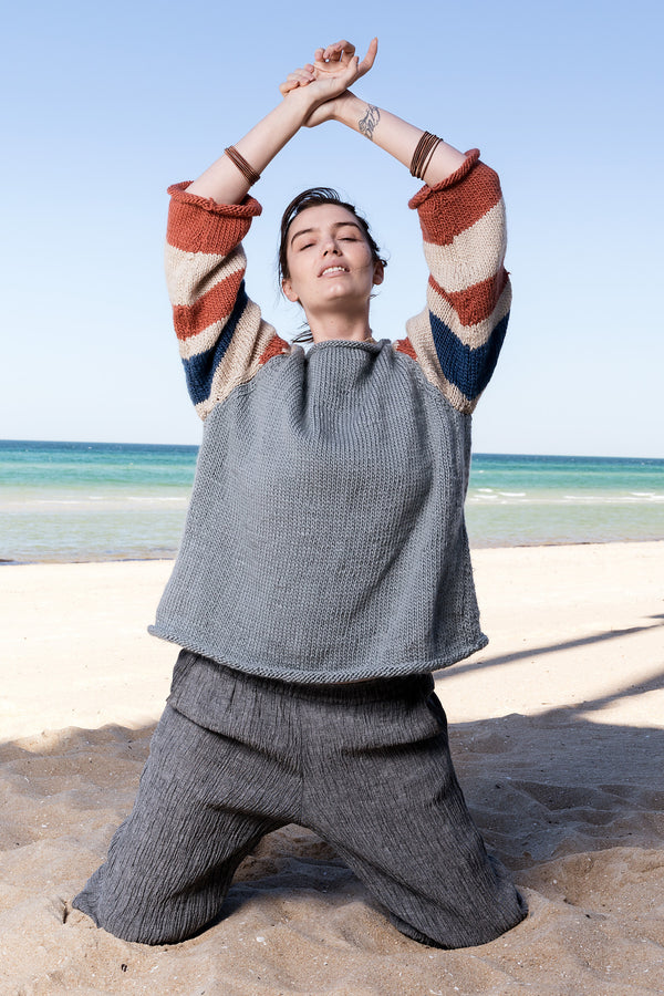 Wool hand-knitted wide jumper with striped sleeves