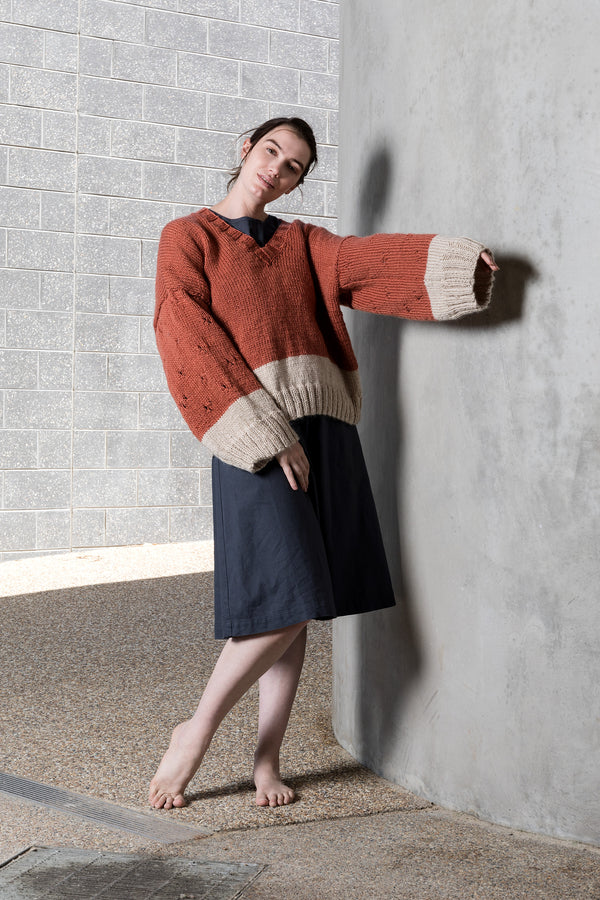 Pure wool wide sleeve jumper with sleeve detail and a V neck